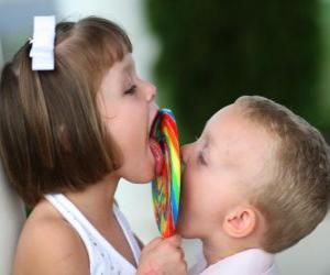 A girl and a boy sucking a big lollipop puzzle