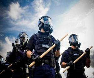 Agents of riot police with baton in hand puzzle