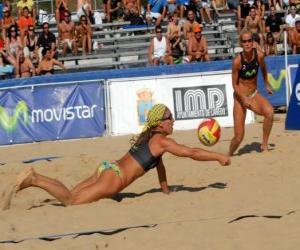 Beach Volleyball - Player of saving a ball in the eyes of his companion puzzle