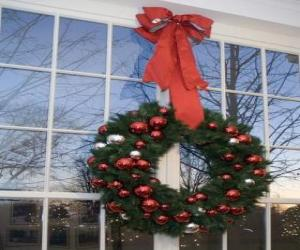 Big Christmas wreath decorated with a large ribbon and baubles puzzle