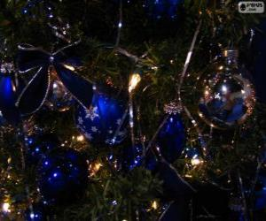 Blue balls decorating a Christmas tree puzzle