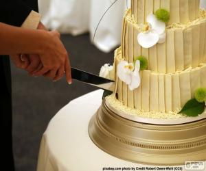 Bride and groom cutting wedding cake puzzle