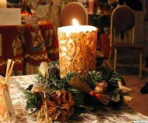 Candle ignited as a centerpiece adorned with sprigs of holly and fir puzzle