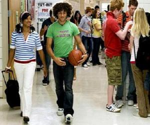 Chad (Corbin Bleu) and Taylor (Monique Coleman) in the corridor of the institute puzzle