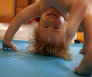 Child doing the nacked somersault puzzle