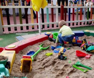 Child in sandbox puzzle