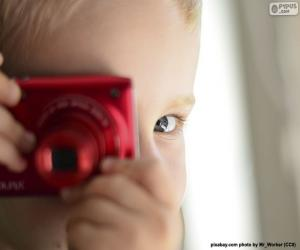 Child with photo camera puzzle