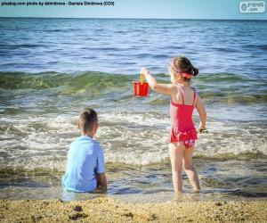 Children enjoying the beach puzzle