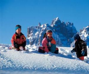 Children enjoying the Christmas holidays, are playing in the snow puzzle