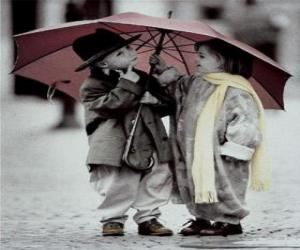 Children walking in the rain with her umbrella puzzle