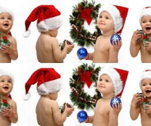 Children with Santa Claus hats and playing with Christmas decorations puzzle