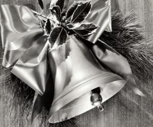 Christmas bell decorated with holly leaves and a ribbon with a big bow puzzle
