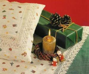 Christmas candle burning along with other Christmas decorations puzzle