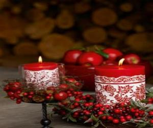Christmas Candles lit and decorated with red berries puzzle
