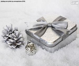 Christmas gift on the snow puzzle