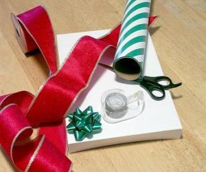 Christmas gifts with decorative ribbon and scissors puzzle
