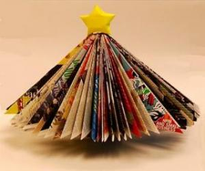 Christmas Tree Made From Leaves Of Magazines And A Yellow Star At The Tip