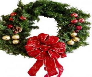 Christmas wreath decorated with a large ribbon and balls puzzle