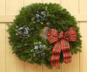 Christmas wreath hanging on the door of a house puzzle