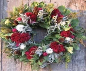 Christmas wreath made of various plant elements puzzle