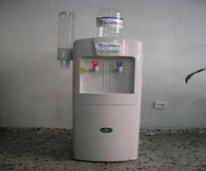 Cold water dispenser with water tank above the dispenser cups puzzle