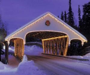 Covered bridge decorated for Christmas puzzle