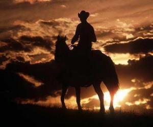 Cowboy riding at dusk puzzle