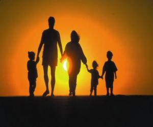 Family, father, mother and children walking at dusk tre puzzle