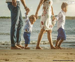 Family walking along the beach puzzle