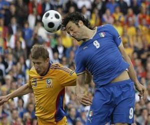 Footballer jumping to head the ball or to hit the ball with the head puzzle