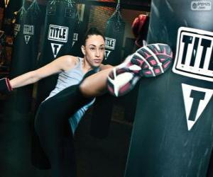 Full contact or kickboxing fighter training hits on the sack puzzle