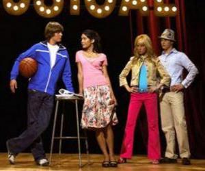 Gabriella Montez (Vanessa Hudgens), Troy Bolton (Zac Efron), Ryan Evans (Lucas Grabeel), Sharpay Evans (Ashley Tisdale) in the scenario puzzle