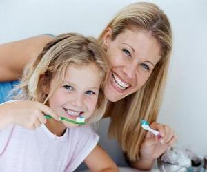 Girl brushing her teeth, an essential practice to dental health puzzle