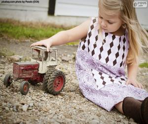 Girl playing with a tractor puzzle