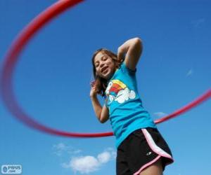 Girl playing with hula hoop, hula hoop spinning at the waist puzzle