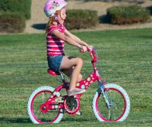 Girl riding a bicycle in the park in spring puzzle