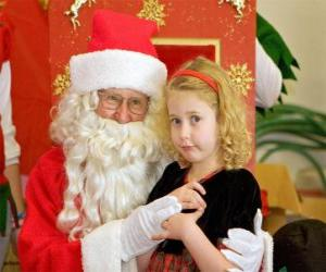 Girl talking to Santa Claus sitting on his lap puzzle