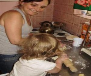 Grandmother teaching her granddaughter to cook puzzle