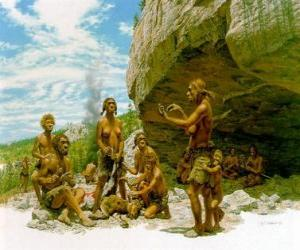 Group of men of Neanderthal under the protection of a rock shelter, the individuals realising different activities: chartting stones, others preparing the hunting puzzle