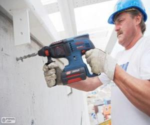 Handyman prepared to work with the drill puzzle