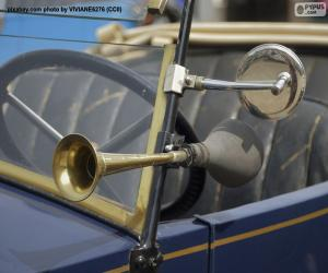Horn and rear-view mirror of an old car puzzle