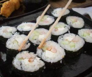Japanese food with chopsticks, it is known as maki because is sushi rolled with seaweed puzzle