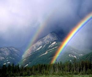Landscape with rainbow, sun, clouds puzzle