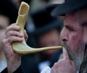 Man playing the shofar. Wind musical instrument typical from Jewish holidays puzzle