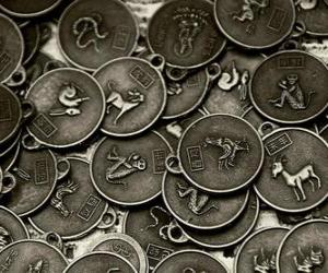 Medals with the signs of the Chinese zodiac puzzle