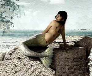 Mermaid sitting on a rock beside the sea puzzle