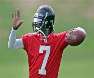Michael Vick in action, ready to attempt a forward pass puzzle