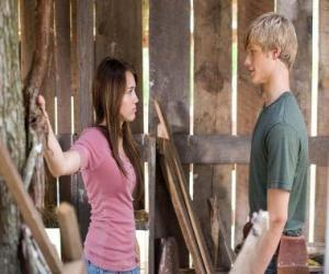 Miley Stewart (Miley Cyrus) speaks with Travis Brody (Lucas Till) puzzle