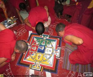 Monks making a mandala puzzle