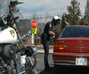 Motorized police officer with his motorcycle and put a fine on a driver puzzle
